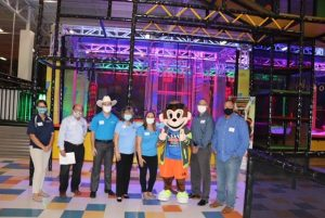 From Left to Right: Sarah Rogers, Pasco County Utilities; Steve Spratt, FGUA Systems Manager; Austin Groover, Urban Air Adventure Park; Patti Clark; FGUA, Caytee Hollingsworth, FGUA; Urby, Urban Air Adventure Park Mascot; Mike Carballa, Pasco County Assistant County Administrator—Public Infrastructure; and Pasco County Commissioner Mike Wells.
