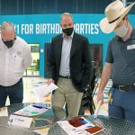 From left to right: Ron Oakley (Pasco County Commissioner), Michael Carballa, P.E., (Pasco County Assistant County Administrator, Public Infrastructure), and Austin Groover (Urban Air Adventure Park) evaluating 1st grade posters.