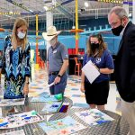 Final Judging panel members discuss which 3rd grade posters will place 1st, 2nd, and 3rd.